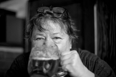 Czech photographer Libuse Jarcovjakova drinking a beer at the 'Orlik' pub.