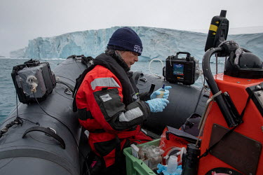 Dr Kirsten Thompson, lead scientist on the Arctic Sunrise collecting water for eDNA sampling near Paulet Island at the entrance to the Weddell Sea.  Environmental DNA monitoring uses filters to trap f...