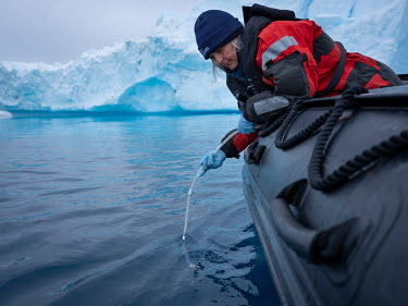 Dr Kirsten Thompson, lead scientist on the Arctic Sunrise takes water samples for eDNA sampling near Paulet Island at the entrance to the Weddell Sea.  Environmental DNA monitoring uses filters to tra...