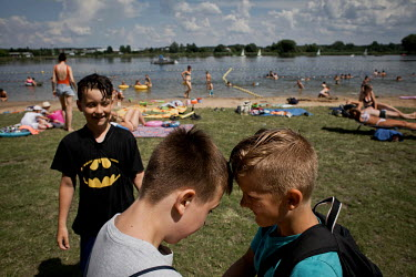 Boys playing on a lakeside beach, during the day organised by 'Our Home', a facility for troubled families and children in need, run by father Edward Konkol from the Divine World Missionaries (SVD) or...