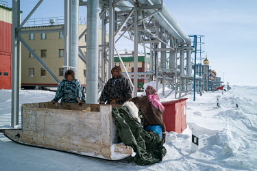 Indigenous Nenets, Roman and Eduard, selling fish to the workers at the Bovanenkovo gas field. The nomadic Nenets can ride over 200 km on a snowmobile in order to sell their goods. They do not need sp...