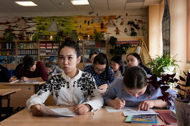Nenets children take part in a lesson on the Nenets language and literature at their boarding school. The school is attended by children whose families generally still live and work out on the tundra,...