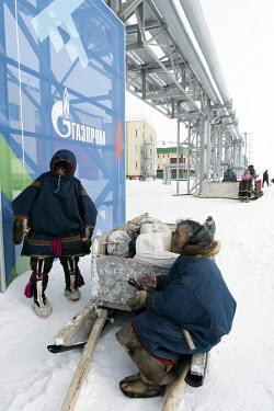 Indigenous Nenets, Mikhail (L) and his grandson Anikhasovo (17), selling fish to the workers at the main entrance to the Gazprom Bovanenkovo gas field. Mikhail's camp is situated 30 km from Bovanenkov...