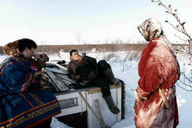 Eyko, a Nenets activist, talks with friends outside his tent ('chum'). He created an internet media site called 'Golos Tundri' (Voice of the Tundra) that seeks to unite herders, fight for their rights...