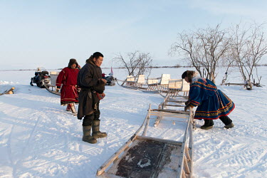 Eyko, a Nenets activist who flies a communist party flag from his snowmobile, with newly built sleighs he has bought for himself and others. He created an internet media site called 'Golos Tundri' (Vo...