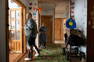 An elderly couple in their home in Panaevsk, a Nenets settlement in the tundra situated on the banks of the Ob River. They waited several years for the apartment which was given to them by the state i...
