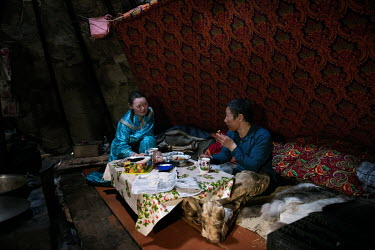 Lyuba and Vasily eating a meal laid out on a table, the only piece of furniture the nomads use in daily life, in their tent ('chum').  There is a strict segregation of duties in a daily life of noma...