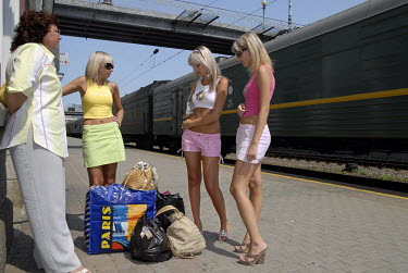 A mother and her two daughters waiting for a train at Vladivostok railway statio, the terminus of the Trans-Siberian Express.