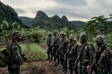 Soldiers from the Thai army's 4th Infantry Regiment patrol along the border with Myanmar looking out for illegal migrants crossing into Thailand amid a spike in COVID-19 cases in Myanmar.