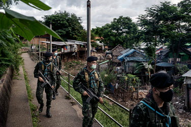 Soldiers from the Thai army's 4th Infantry Regiment look into a 'no man's land' settlement of Burmese (Myanma) people as they patrol along the border with Myanmar looking out for illegal migrants cros...