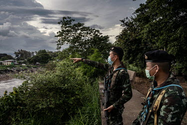 Soldiers from the Thai army's 4th Infantry Regiment patrol along the border with Myanmar looking out across the Moei River for illegal migrants crossing into Thailand amid a spike in COVID-19 cases in...
