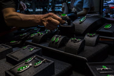 Chinese customers buy jade jewellery at one of the many jade shops in the Jiagao market.