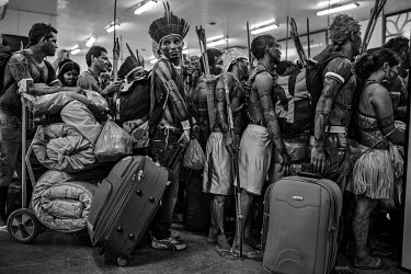 Munduruku Indians line up to board a plane at Altamira Airport after protesting against the construction of the Belo Monte Dam on the Xingu River. The Mundurukus inhabit the banks of the Tapajos River...