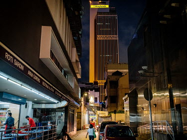 The Maybank Tower rises above the city.