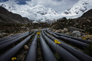 Pipes used to siphon and drain water from Lake Palcacocha in the Cordillera Blanca mountain range. Due to the increased volume of water, originating from melting glaciers around the lake, avalanches h...