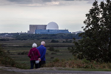A couple walking in the Minsmere RSPB (Royal Society for the Protection of Birds) reserve, near Sizewell Nuclear Power station.