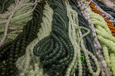 Strings of jade beads for sale at one of the many stalls in the Jiagao jade jewellery market.