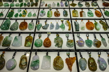 Various jade pendants for sale at one of the many stalls in the Jiagao jade jewellery market.