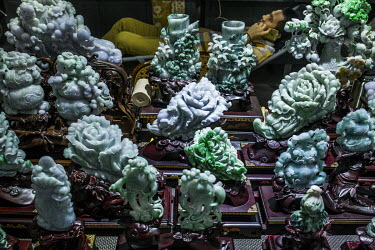 Carved jade ornaments for sale at one of the many stalls in the Jiagao jade jewellery market.