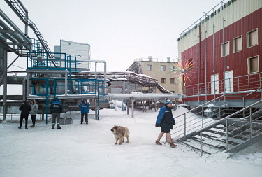 Staff smoking outside the accommodation and staff living quarters at the Gazprom Bovanenkovo natural gas field, on the Yamal Peninsula.