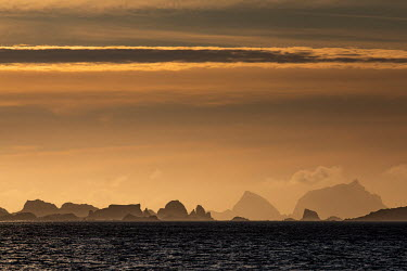 The sun sets over the South Shetland Islands near Greenwich Island.  The Greenpeace ship MY Esperanza is on the final leg of the pole to pole voyage from the Arctic to the Antarctic. The almost year...
