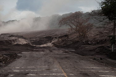 Roughly 3 metres of volcanic debris block access along National Route 14 near the former town of San Miguel los Lotes following a violent eruption by the Fuego Volcano which completely destroyed the c...