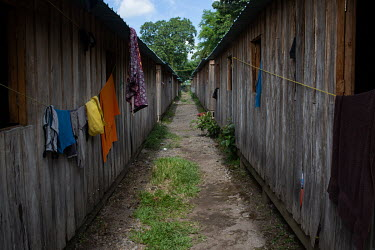 Clothes hang-dry from windows at the Single-Family Transitional Shelters in Escuintla City.