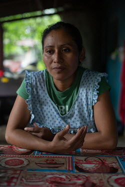 Ada Camposeco, 34, who was born in Chiapas, Mexico, while the community was there as war refugees, sits on her family table after lunch at their home in the 15 de Octubre La Trinidad community. Ada's...