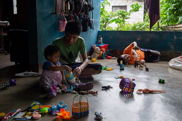 The children of Ada Camposeco and Estuardo Lorenzo play in their porch at their home in the 15 de Octubre La Trinidad community. From left to right: Keren Esmeralda Esperanza, 19 months old, Wesles Da...