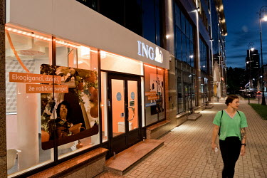 People walking past a branch of the ING Bank in central Warsaw.