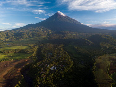 North-facing landscape of the community of La Trinidad that shows how it is surrounded by three volcanic debris causeways as well as the Fuego and Acatenango volcanoes in the background. The community...