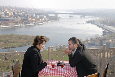 A couple drink tea at the The Pierre Loti Cafe, which offers a splendid view over the Bosphorus. The cafe is named after French novelist and naval officer Pierre Loti.