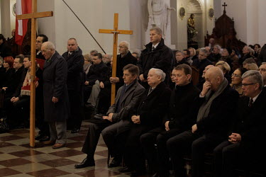 The head of the ruling Law and Justice party (Prawo i Sprawiedliwosc, PiS) Jaroslaw Kaczynski (centre with grey hair) praying with Marek Kuchcinski to his left, at the Seminary Church, during a mass t...