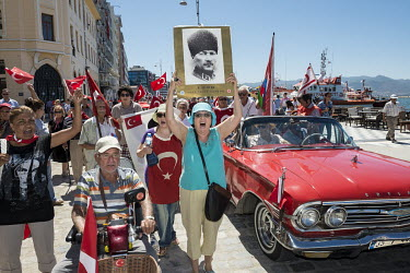 A woman holds up a portrait of Ataturk during a Kemalist demonstration on Victory Day, 30 August, a national holiday commemorating the 1922 Turkish War of Independence.