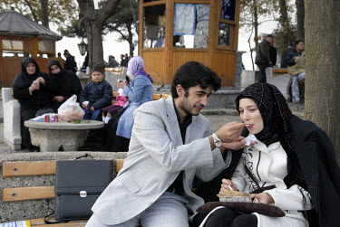 A man feeds his partner as a couple have a picnic in Camlica Park in the conservative district of Uskudar on the Asian side of the Bosphorus.