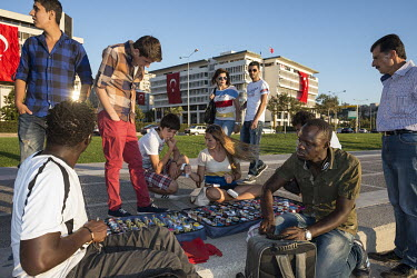 Senegalese migrants selling watches from a pitch on the sea front.
