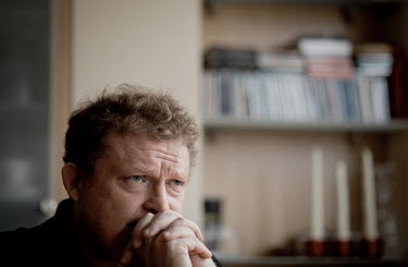Writer Tomasz Piatek at his flat in central Warsaw.