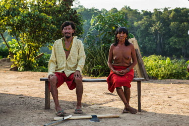 An Arawete couple in the village Paratati on the banks of the Xingu River. The company responsible for the Belo Monte hydroelectric dam has financed several works in the village. But many of these cha...