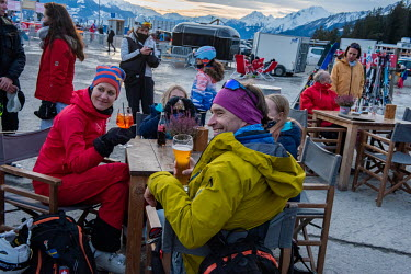 A visiting Swedish family having a drink after skiing, in a bar famous, in normal times, for its shoulder-to shoulder 'apres-ski' crowds.