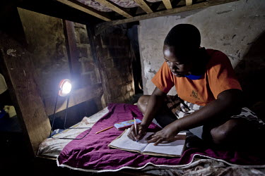 In the girls' dormatory at the Kirugaluga Baptist Primary School, every evening, the matron (woman in charge of the dormatory) lights the room with solar lights.