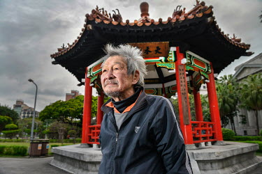 Homeless 73-year old Jimmy Bai in front of the pagoda in which he sleeps, in 228 Peace Park.