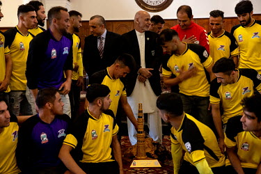 President Ashraf Ghani, Vice-President Amrullah Saleh with the winning team at a championship football match.