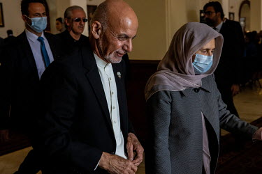 President Ashraf Ghani and his wife attends a championship football match.