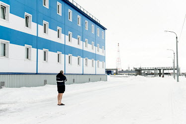 A worker smoking in front of a hostel near Obskaya railway station before his departure for a one month shift working on the Gasprom Bovanenkovo gas field.�