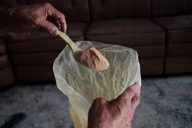 Samijan, a traditional healer, showing a powder containing dried snakes and geckos along with roots and herbs at his home in Kediri. The powder is sold for use in Chinese medicine. Samijan specialises...