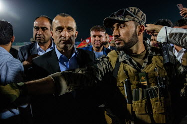 Amrullah Saleh, Vice-President of Afghanistan, former interior minister and National Security Director, surrounded by security officers at a football match where he was due to present a trophy to the...