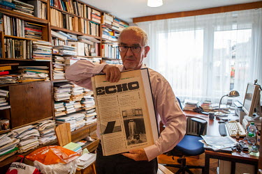 Martin Butora, sociologist, writer, university professor and diplomat, in his flat with an old copy of 'Echo', a student newspaper published 6 April 1968.