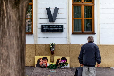 A memorial to the Velvet Revolution with photographs to the murdered journalist Jan Kuciak and his fiancee Martina Kusnirova. With the dedication 'Only those who struggle for their freedom are worthy...