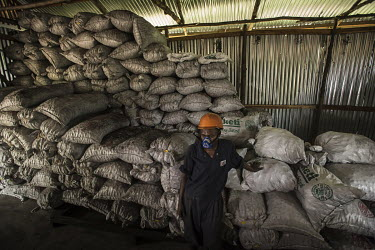 A worker with sacks of fuel briquettes produced by Green Bio Energy based on agricultural residues and leftover coal, its combustion up to twice as slow as traditional fuels, allowing savings of 40 to...