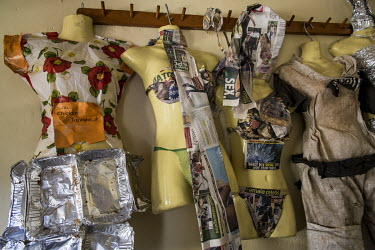 Clothes made from waste are worn on a mannequin in the studio of Gisa Jr Gong Brian, an artist who creates, along with members of his group Afrika Arts Kollective, pieces from waste: clothes, objects,...